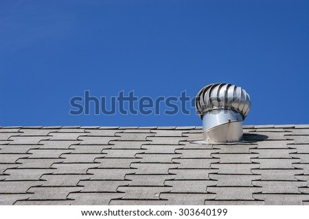 Roof top ventilation system for heat control of commercial building - stock photo