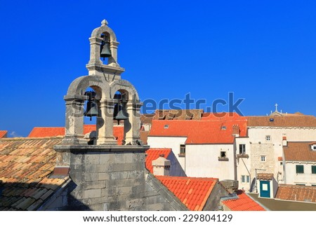 Roof tops and bell tower of a church in the old town of Dubrovnik, Croatia - stock photo