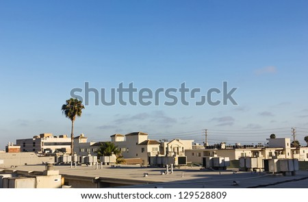 Roof tops of numerous apartments in the city. - stock photo