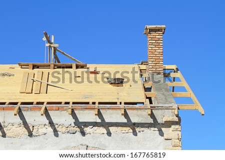 Roof under construction. Carpentry work