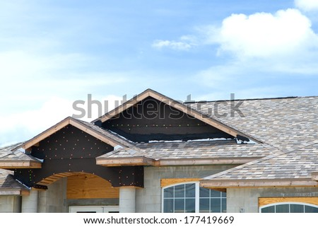 Roof under construction in a new build house - stock photo