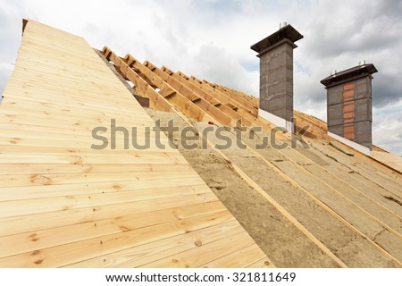 Roof insulation stock images royalty free images for Mineral wool installation