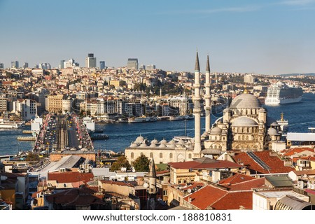 roof Valide Khan, Galata Bridge and Yeni Cami (The New Mosque) in Istanbul, Turkey - stock photo