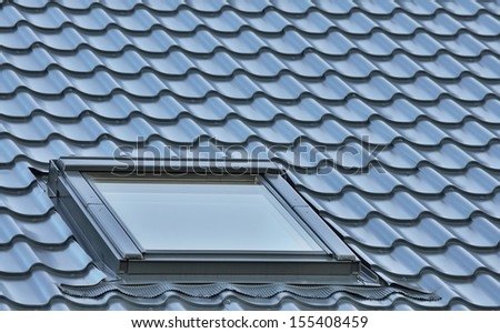 Roof window on a grey tiled rooftop, large detailed loft skylight background, diagonal roofing pattern - stock photo