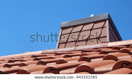 Roof with red tile and chimney - stock photo