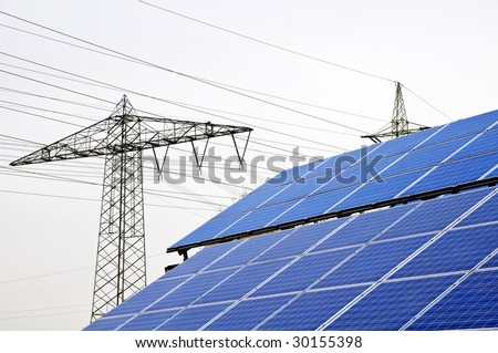 roof with solar installation and power pole - stock photo