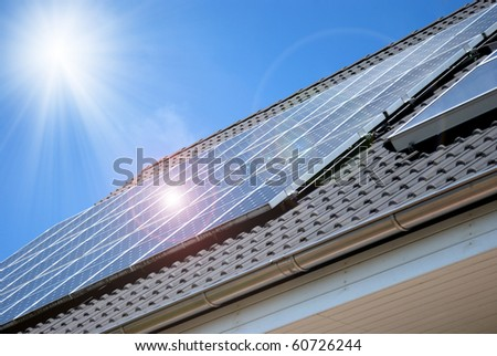 Roof with solar panel fragment - stock photo