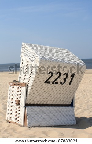 roofed wicker beach chair - stock photo