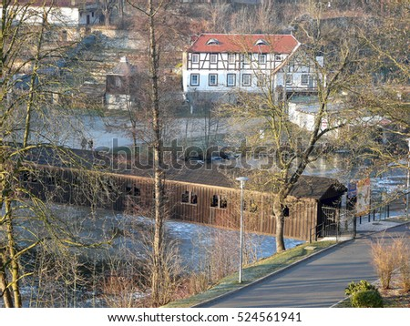 Roofed wooden bridge across the Eger river in Cheb in the Czech Republic