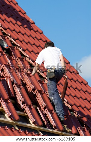 Roofer at work - stock photo