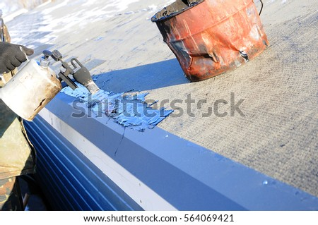 Roofer Construction Worker Installing Bituminous Roof Tiles Using A  Blowtorch