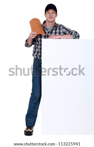 Roofer holding tile - stock photo