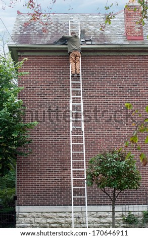 Roofer Replacing Slate to Roof - stock photo