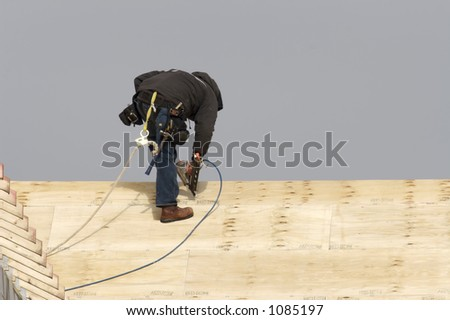 Roofer with nail Gun - stock photo