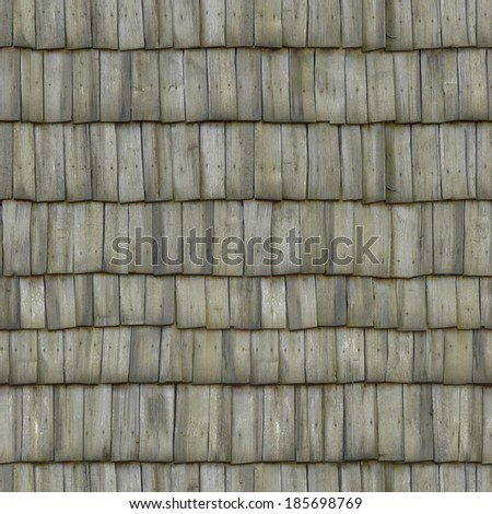 Roofing consisting of gray planks set crookedly.