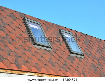 Roofing construction with new installed attic skylights or roof windows - stock photo