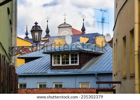 Roofs and lanterns of old city of Vilnius, Lithuania - stock photo