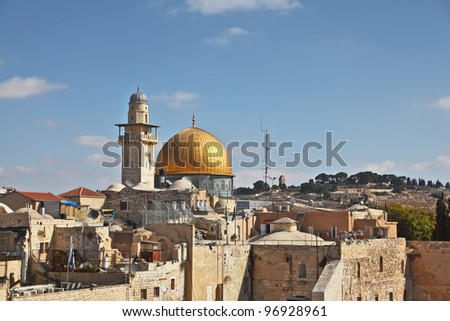 Roofs of Jerusalem. Glints in the sun gold Dome of the Rock