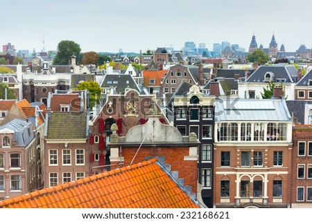Roofs of old city in Amsterdam - stock photo