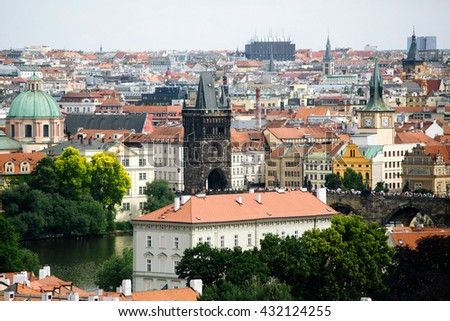Roofs of the city and Charles Bridge in Prague from the high point - stock photo