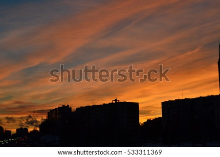 roofs of the city on the background of a beautiful winter sky