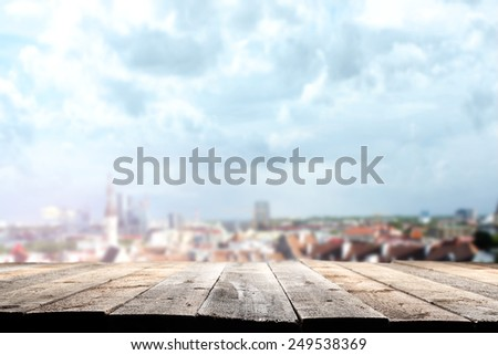 roofs of town and wooden floor  - stock photo