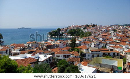 Roofs on Skiathos Island, Greece. Skiathos Island is located in the northern part of Sporades islands group. The main towns are the Town of Skiathos, it is located to the northeast next to a lagoon. - stock photo