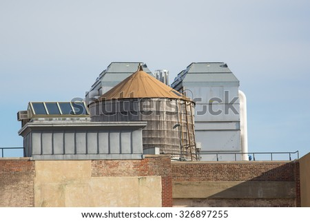 Rooftop infrastructure including water tower and skylight