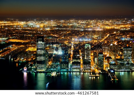 Rooftop night view of New Jersey from Manhattan downtown with urban skyscrapers