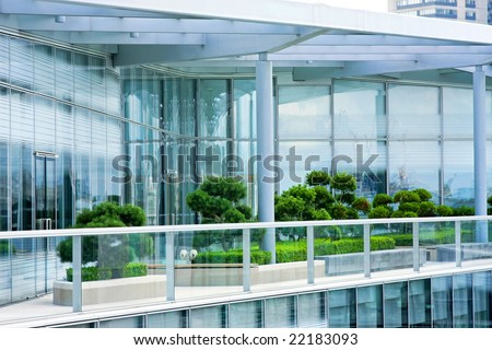 Rooftop penthouse apartment terrace with green garden - stock photo