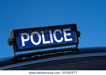 rooftop sign on a vintage 1950's british police car - stock photo