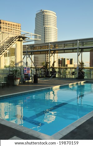 Rooftop swimming pool has a skyscraper view