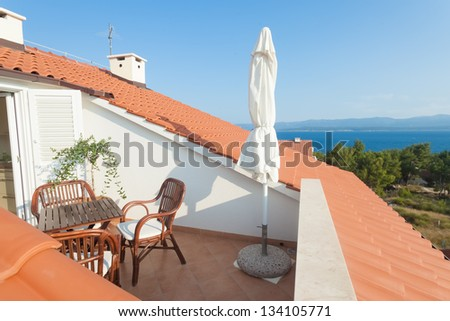 Rooftop terrace with view over sea - stock photo