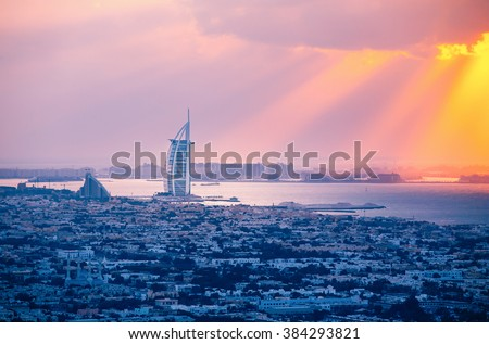 Rooftop view of Dubai at sunset with the seaside.  - stock photo