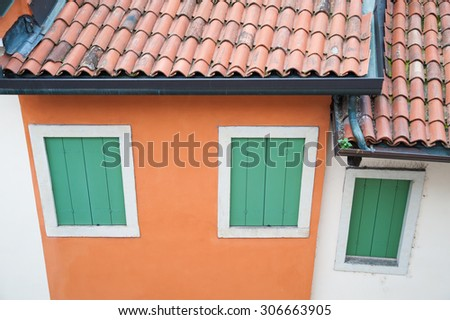 Rooftops and windows of a typical house of Vicenza, North Italy - stock photo