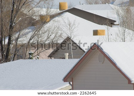Rooftops covered with snow - stock photo