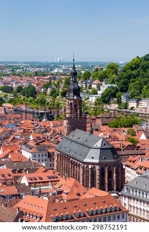 Rooftops of Heidelberg old town and the Church of the Holy Spirit, Baden-Wurttemberg, Germany - stock photo