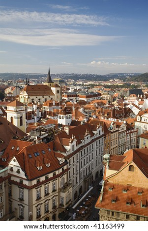Rooftops of Old Town as seen from the Old Town Hall Tower located on Old Town Square. Prague Czech Republic is listed as a UNESCO World Heritage Site. - stock photo