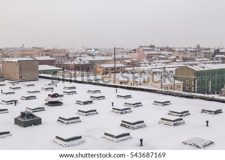 Rooftops of Saint Petersburg covered with snow