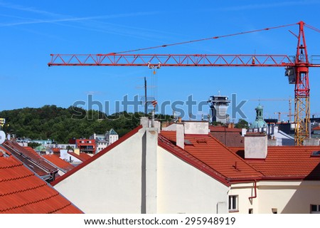 Rooftops with crane construction, park and blue sky in the background, Prague, Czech Republic, Europe