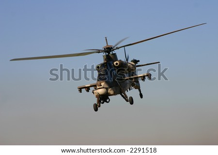 Rooivalk helicopter during flight on a clear day - stock photo
