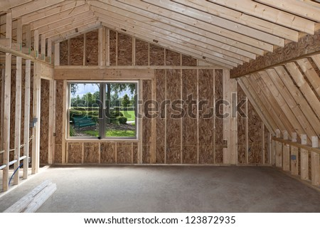 Room addition construction with pitched ceiling and garden view window