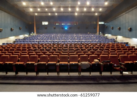 Room at the cinema with a working projector - stock photo