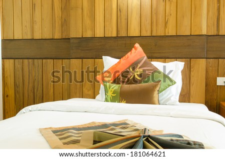 room bed with many pillows - stock photo