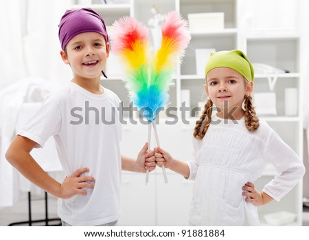 Room cleaning taskforce - kids with dust brushes preparing to tidy up - stock photo