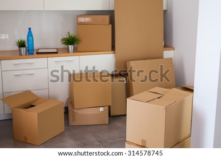 Room full of moving boxes - stock photo