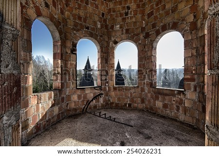 Room in an abandoned and damaged castle - stock photo