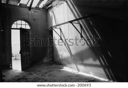 Room in ghost town of Kolmanskop,Namibia. - stock photo