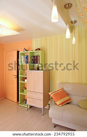 Room in the house. Vertical. Orange and yellow colors.  - stock photo