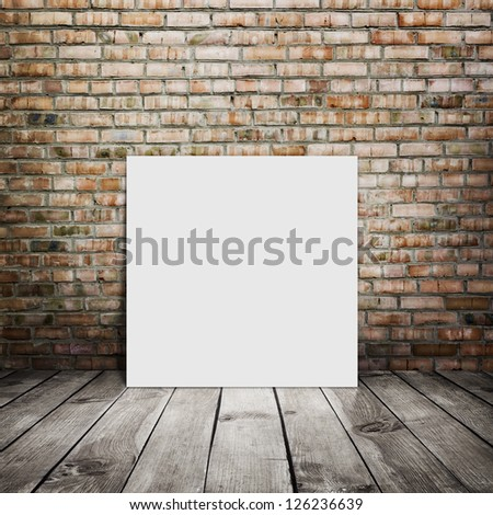 room interior vintage with brick wall, wood floor and white blank placard background - stock photo